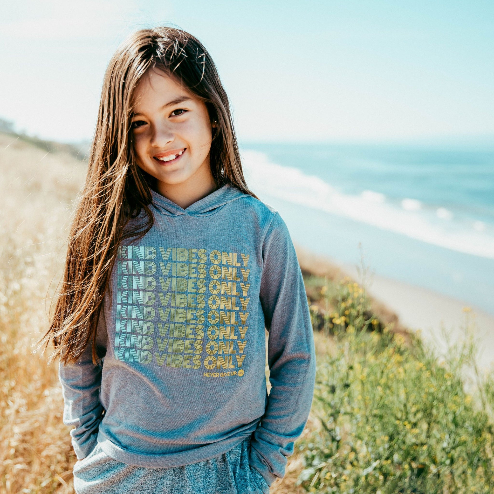 Child wearing kind vibes only hoodie