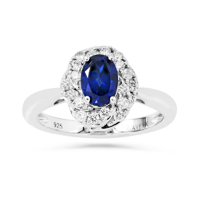 Oval Created Sapphire & 1/3 CT. T.W. Man-made Diamond accent ring in Sterling silver - For The Love of Jewelry