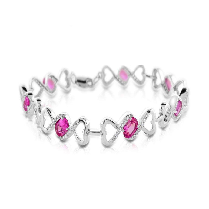 Oval Lab Created Pink Sapphire and White Topaz Heart Bracelet in Sterling Silver - For The Love of Jewelry