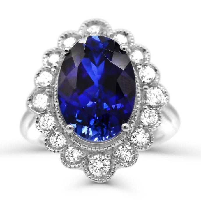 Oval Created Sapphire & 1.0 CT. T.W. Man-made Diamond Halo ring in Sterling silver - For The Love of Jewelry