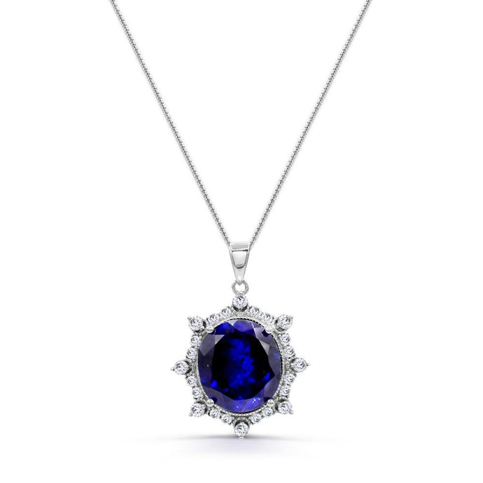 Oval Created Sapphire & 5/8 CT. T.W. Man-made Diamond Pendant in Sterling silver - For The Love of Jewelry
