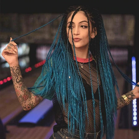 teal colored braids with hair extensions from comfy era
