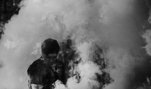 Man covered in a big vape cloud from a sub ohm vape