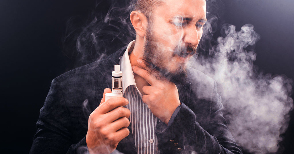 Man coughing from vaping