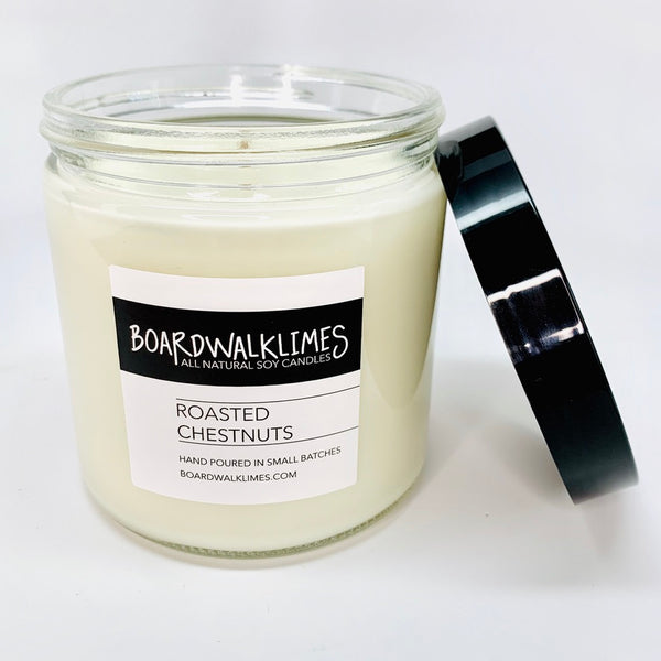 1-wick luxury soy candle in wintery roasted chestnuts scent in a glass jar with a shiny black plastic lid