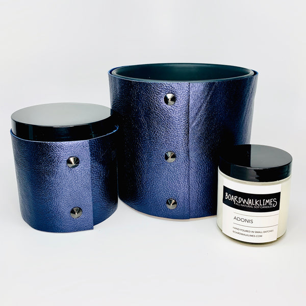 Luxury Soy Candles in metallic sapphire leather sleeves with oil rubbed black studs
