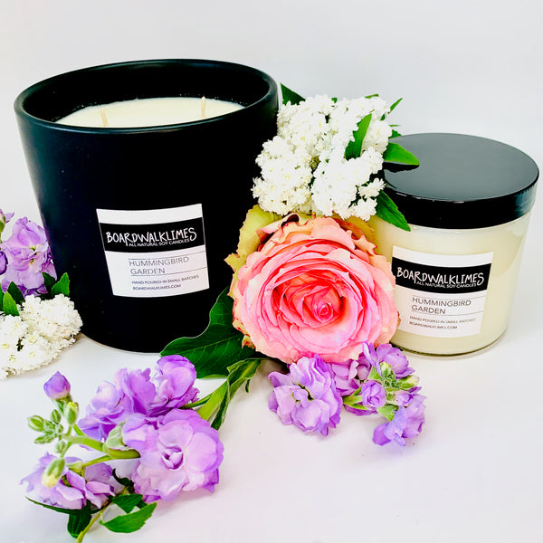Luxury floral scented soy candles and essential oil diffuser oil in rose, lilac, and gardenia fragrances