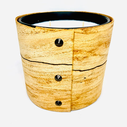 Scented 3-wick large candle in an architectural material called spalted maple with black studs