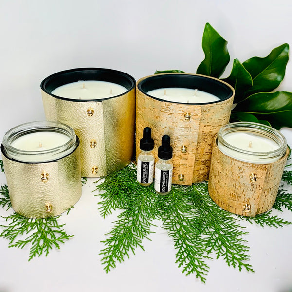 Luxury winter scented soy candles in two different sizes, large 3-wick and 16oz 1-wick. Wrapped in cork with shimmering silver glaze or wrapped in pale metallic gold leather sleeves all with shiny rose gold colored button studs