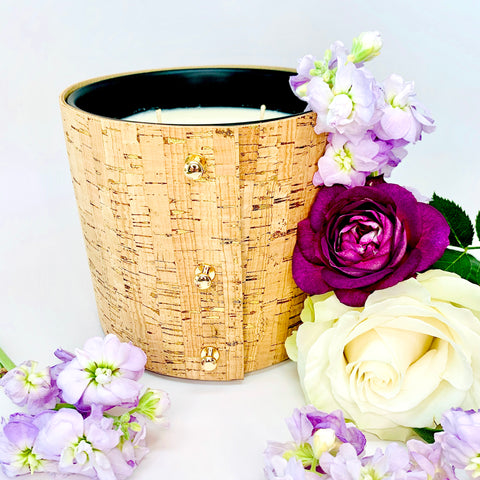 Luxury large soy candles filled with beautiful floral fragrances of rose, gardenia, and lilac wrapped in a cork sleeves with brilliant gold inlays and 3 rose gold button studs
