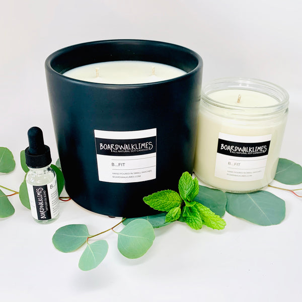 3-wick large luxury soy candle in an handmade matte black ceramic vase,16oz Soy candle in a glass jar with a shiny black lid both in an invigorating and energizing scent