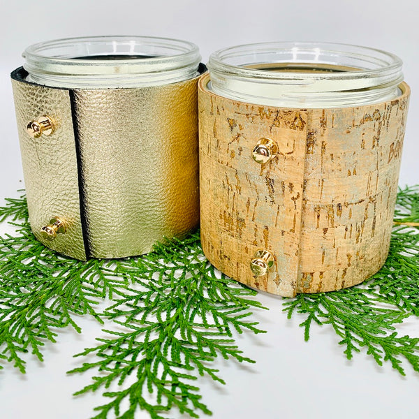 Winter soy candle gift pack of two wintery fragrances, evergreen with spiced fruit and sugary toasted chestnuts in winter cork and pale metallic gold leather sleeves