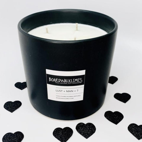 Luxury coffee table sized 3-wick soy candle in handmade ceramic matte black vase with a sexy male cologne scent