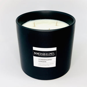 "3-wick high end soy candle in a handmade matte black 5"" ceramic vase"