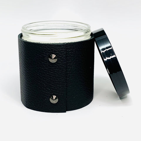 16 oz luxury soy candle in modern clear glass jar with shiny back lid wrapped in premium textured black leather with 2 oil rubbed black studs