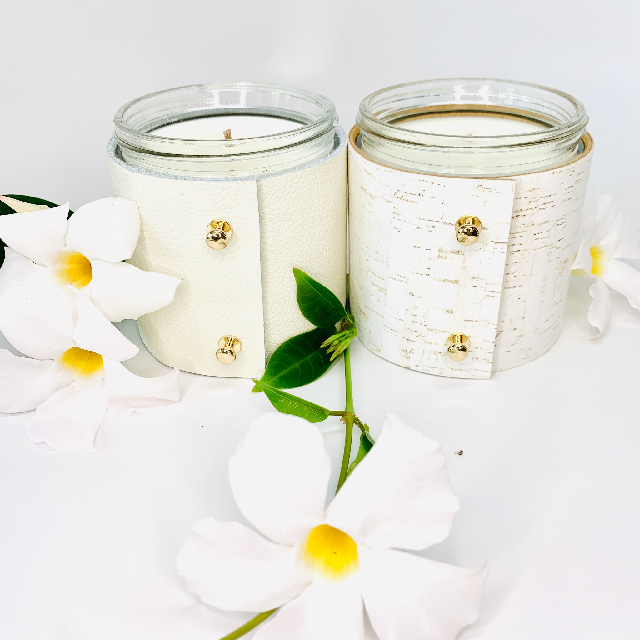 2 Luxury floral soy candles in topical plumeria and beautiful rose and gardenia scented candles wrapped in fine white leather and white cork with gold button studs