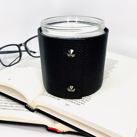 Masculine teakwood and sage scented soy candle wrapped in textured black leather with two black leather studs