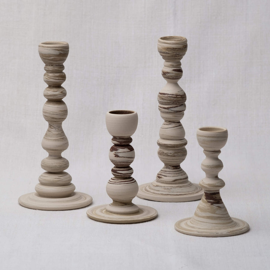 Group of large and small Sandscape Candle Holders