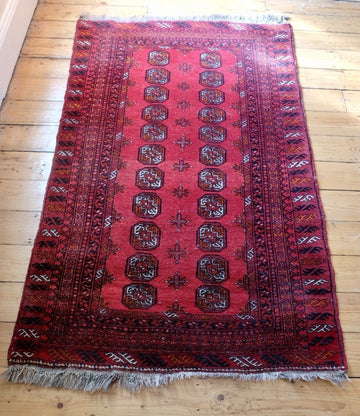 Bokhara handmade wool rug vibrant wine red ground and multiple boarders