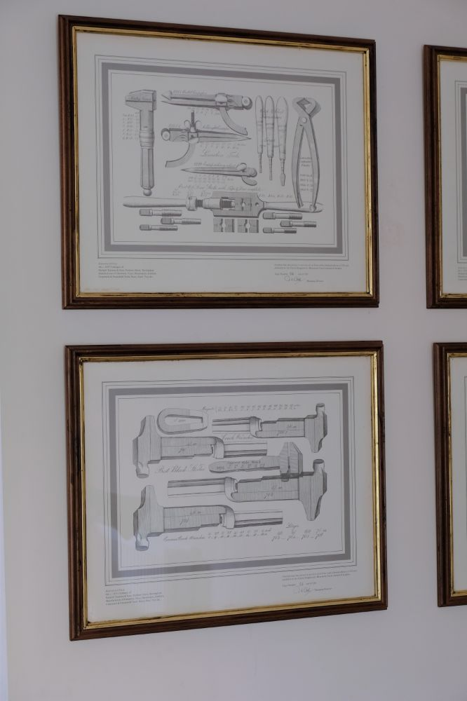 Four limited edition prints of old engineers tools