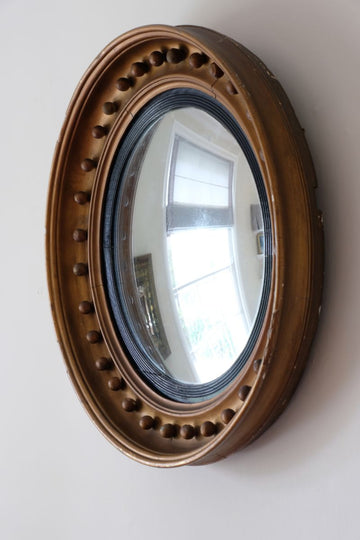 19th Century Giltwood Convex mirror in regency style with shot ball detail.