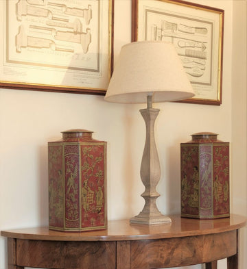 Pair of octagonal shaped Toleware canisters with gilded chinoiserie