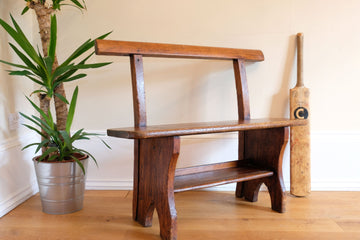 Early 20th century stained pine child's bench with back rest & shoe shelf