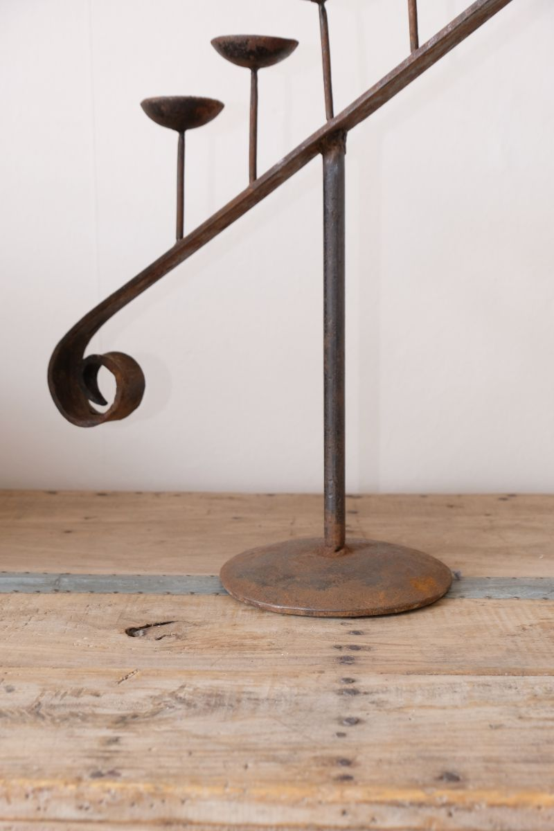 Large wrought iron five stem sloping pricket candlestick