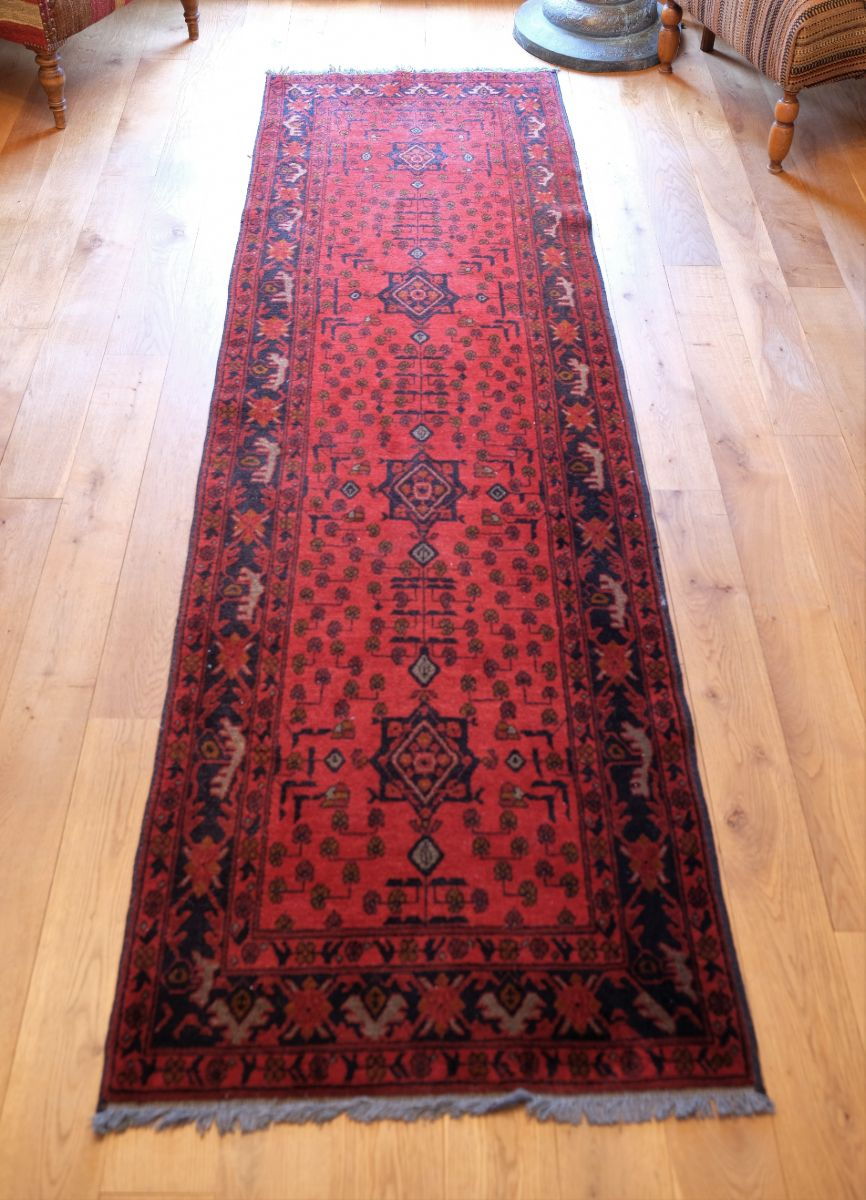 Vintage North West Persian Wool Runner with an all over design upon a red and dark blue ground within multiple borders