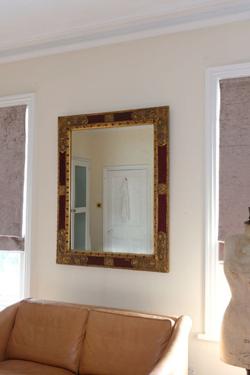 20th Century Italian parcel gilt scarlet painted wall mirror moulded frame.