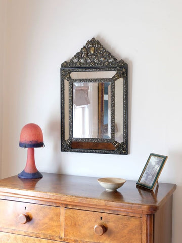 French/Dutch repousse brass cushion framed mirror with arched crest