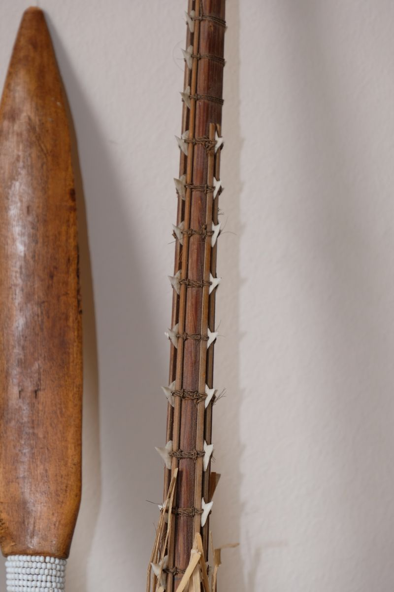 Tribal wooden spear with beads and ceremonial decorative pieces