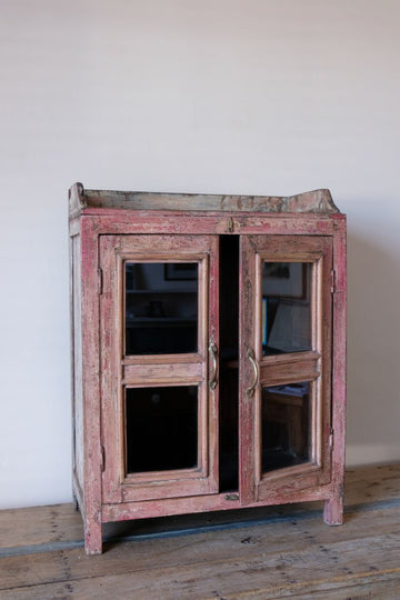 Two Door Glass Cabinet With Reddish Hues