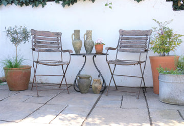 Pair of vintage metal garden chairs with wooden slats