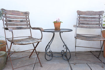 Vintage French Wrought Iron Table with scroll legs and vine leaves