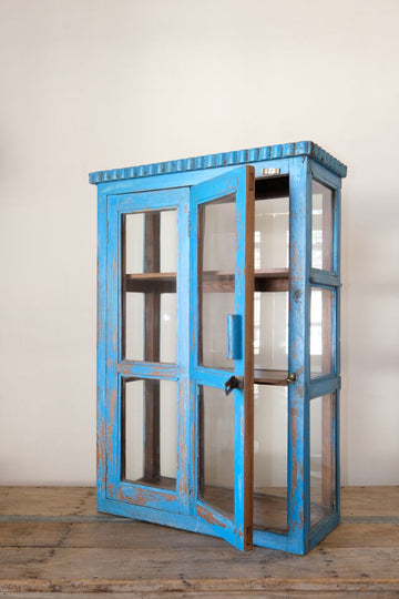 Bright Blue Antique Cabinet With A Bifold Door