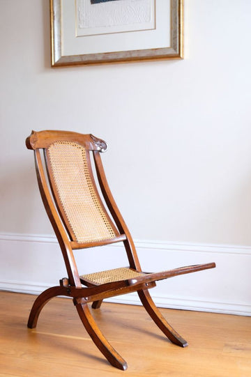 19th Century mahogany framed folding campaign chair, cane work to the seat & back