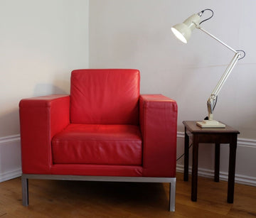 1970's vintage leather armchair in red with stainless steel base and legs