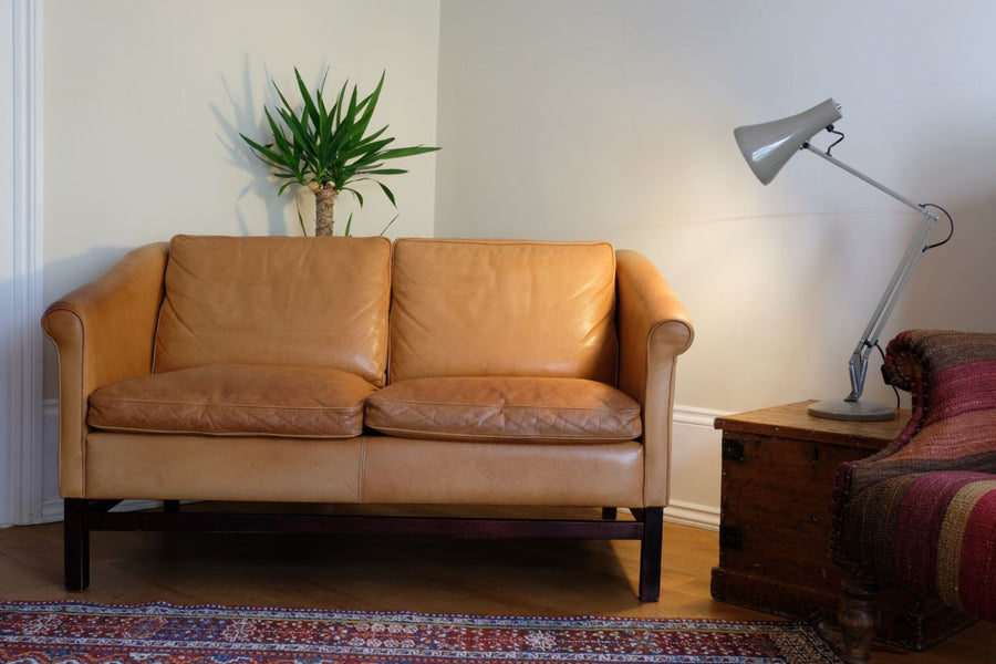 Danish design and manufactured two seat sofa in tan. Made by Stouby.