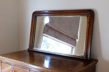 Edwardian overmantle mirror with inlaid detail around the oak frame