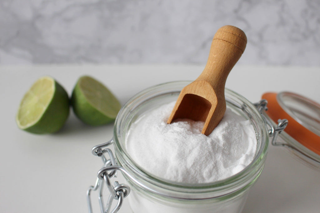 mason jar filled with salt and a wooden spoon