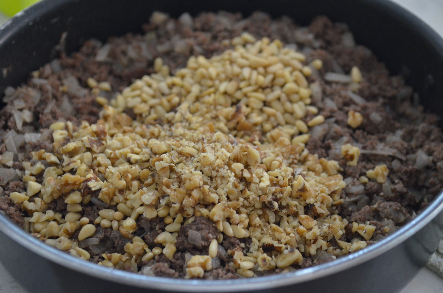 Browned meat walnuts and pine nuts for kufteh