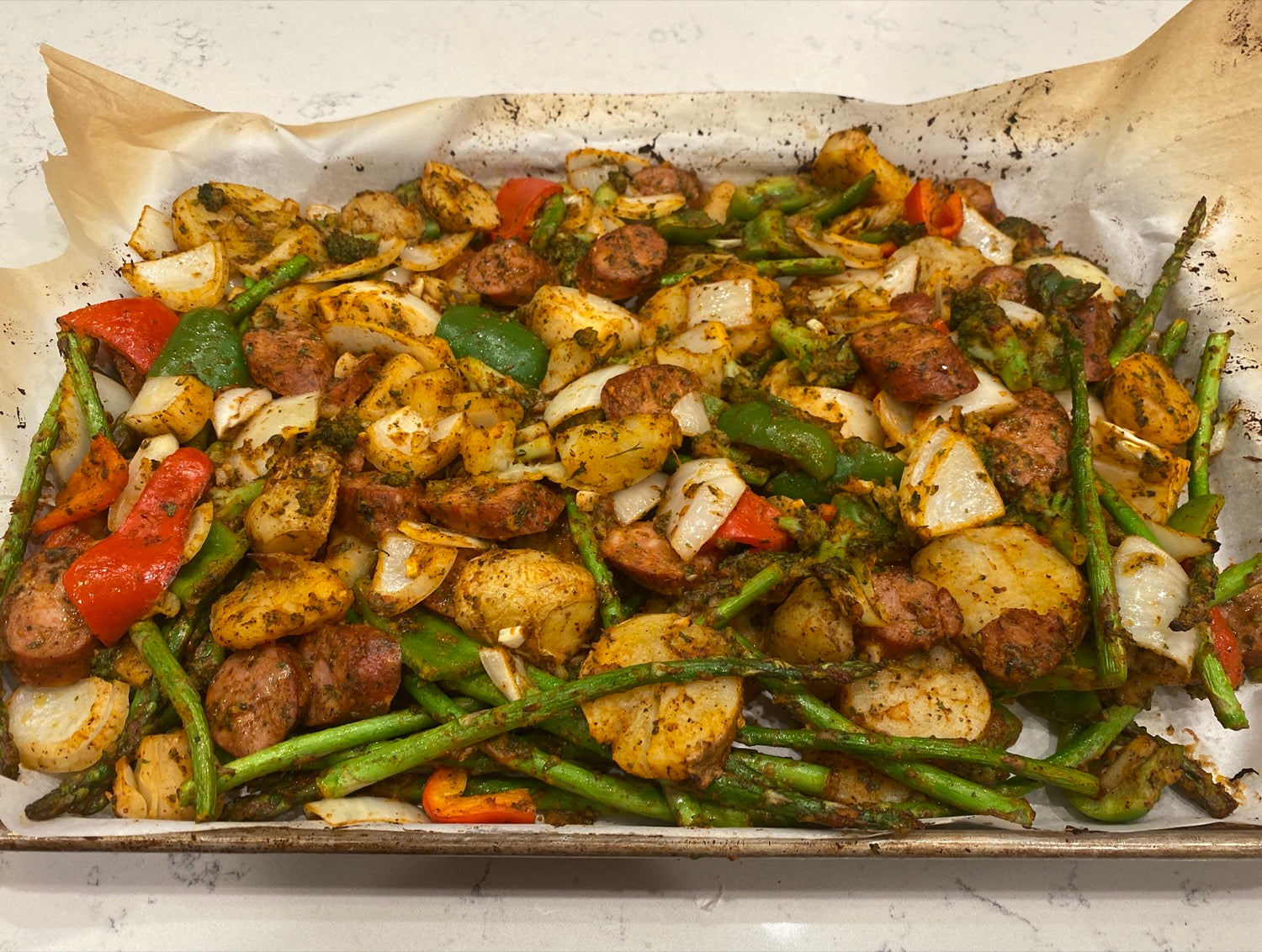 Spread Chicken Sausage and Vegetables on Sheet Pan