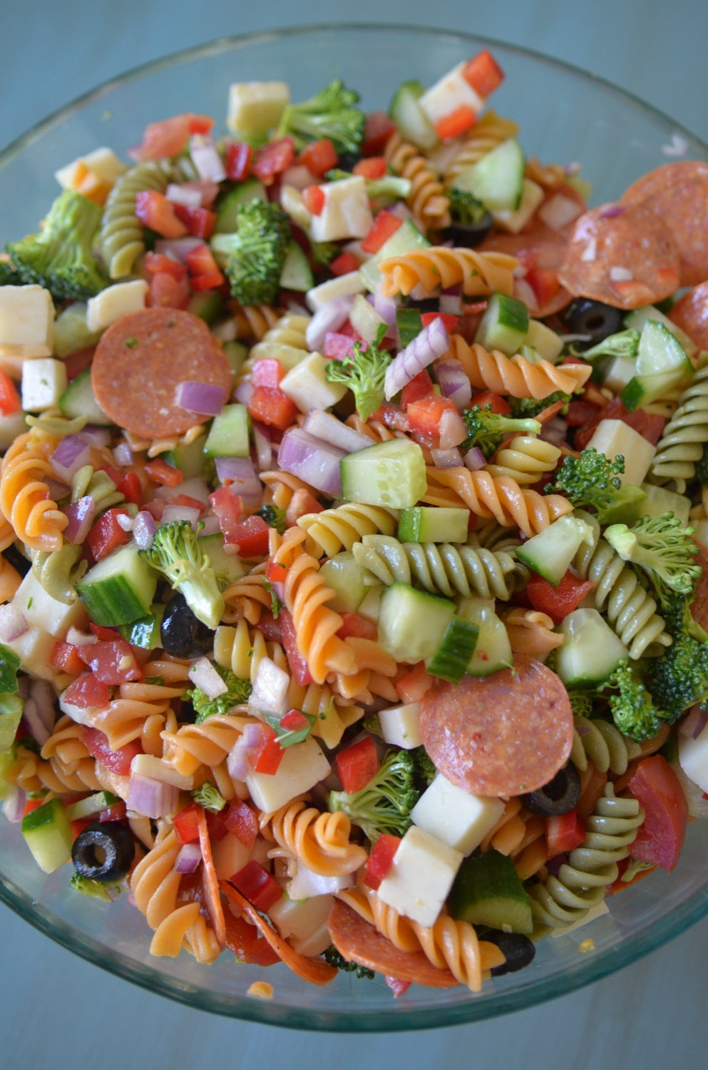 big bowl of tricolor pasta salad with italian dressing