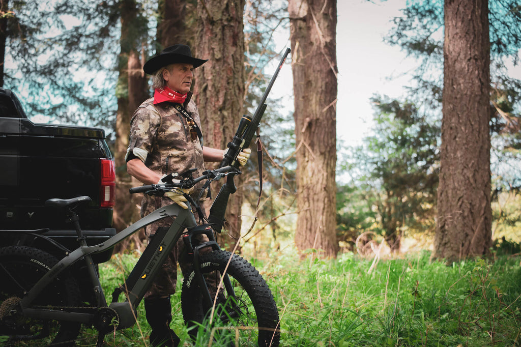 A turkey hunter prepares to scout for turkey on his QuietKat electric hunting bike