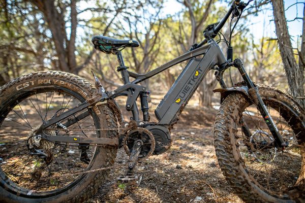 Profile view of a QuietKat electric bike frame covered in mud