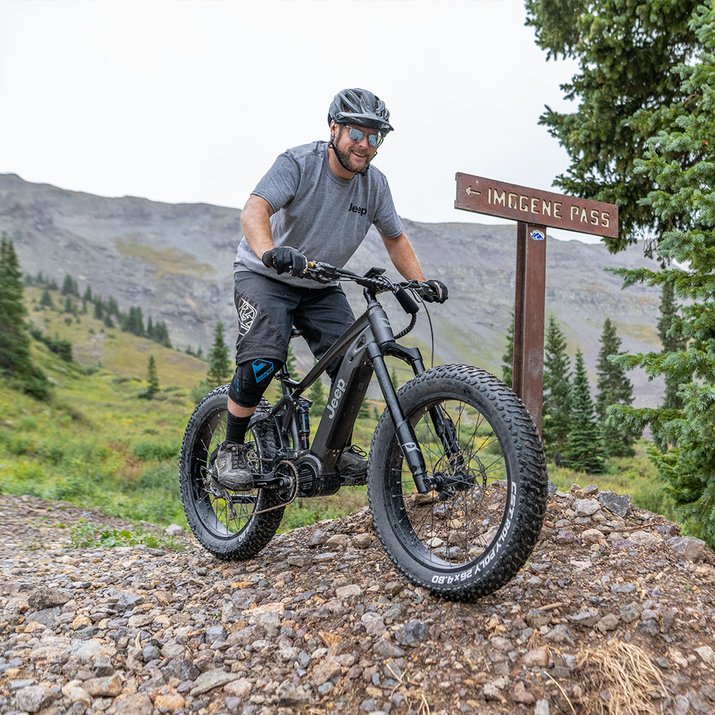 A man rides his QuietKat eBike on the Imogene Pass Trail