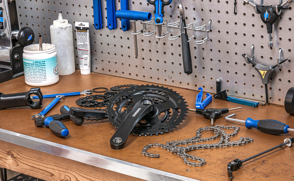 A work bench with tools for fixing electric bikes