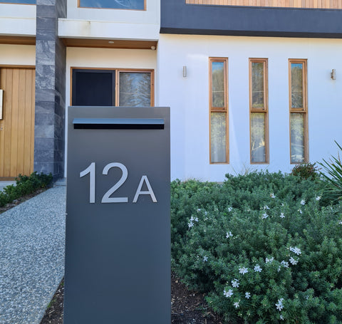 monument letterbox with stainless steel stick on numbers