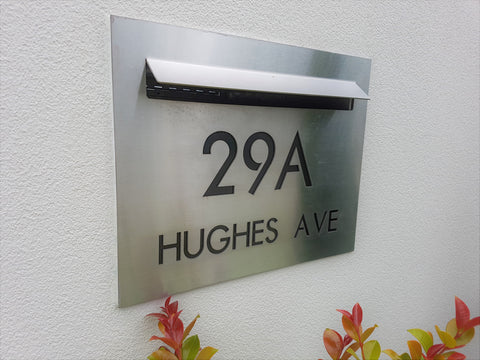 stainless steel custom faceplate with water jet cut out numbers and black backing plate